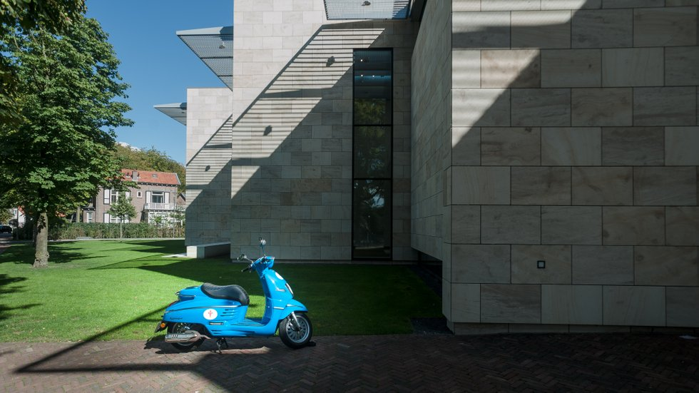 Blue scooter, outside museum MoRe.